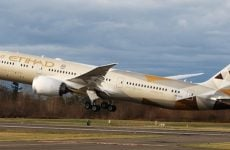 Etihad sells first airline stake amid review