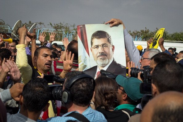 "Egypt's Ousted Mursi Says Jail-Break Trial Is ""Void"""
