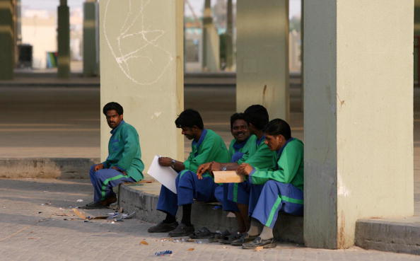Asian workers take a break at Friday Market in Kuwait City